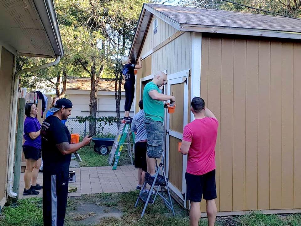 passageways team painting a garage